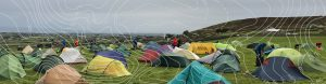 Coloured tents in campsite with grey sky