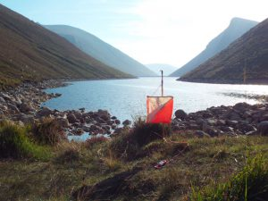 Lone marker in front of reservoir