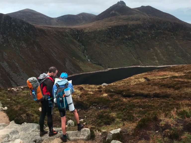 Two competitors overlooking Ben Crom