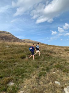 Two runners out on hills with thumbs up