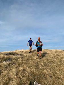 Two runners running towards camera