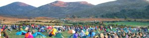 Lots of small coloured tents in front of Mourne Mountains