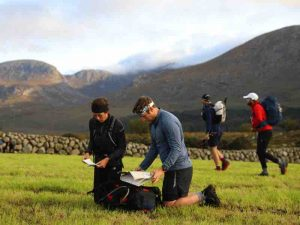 Runners marking up maps