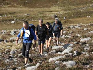 4 people walking through the Mournes