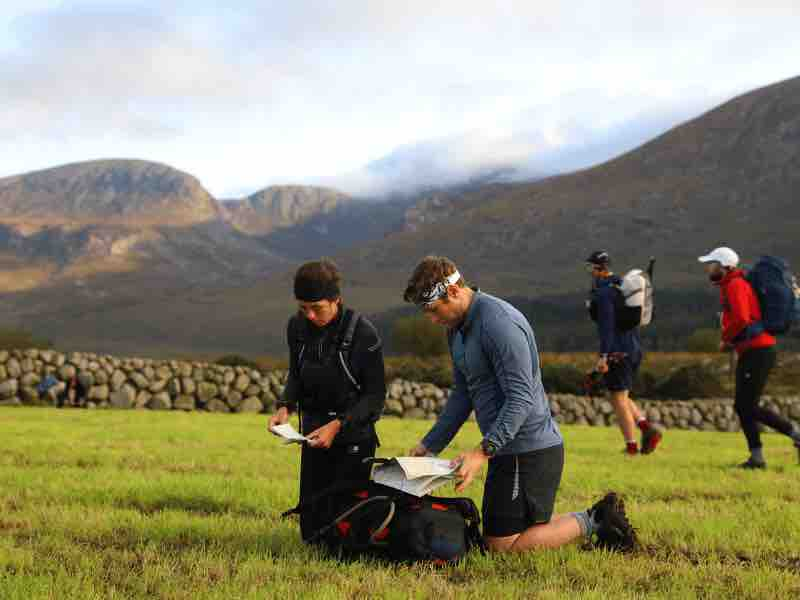 Two men map reading